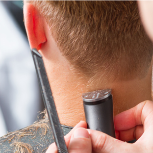 Image of a man getting a haircut