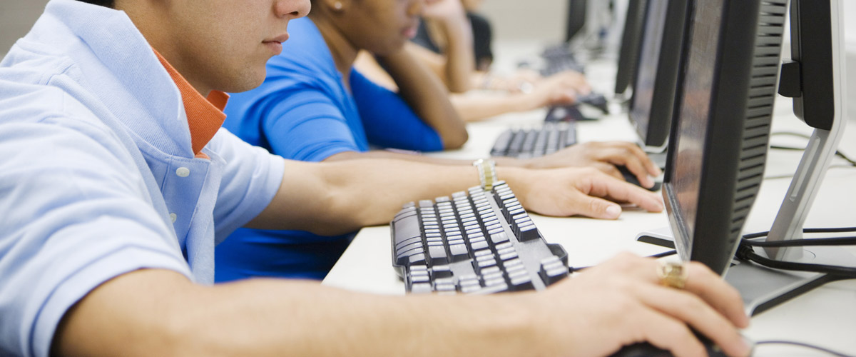 Images of people at computer workstations - Career Resource Center